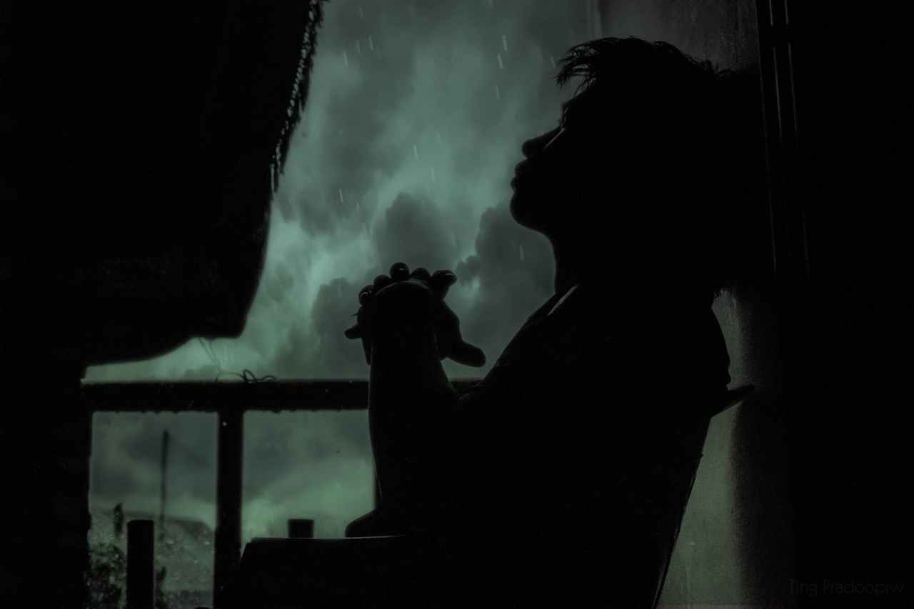 adult alone backlit black and white