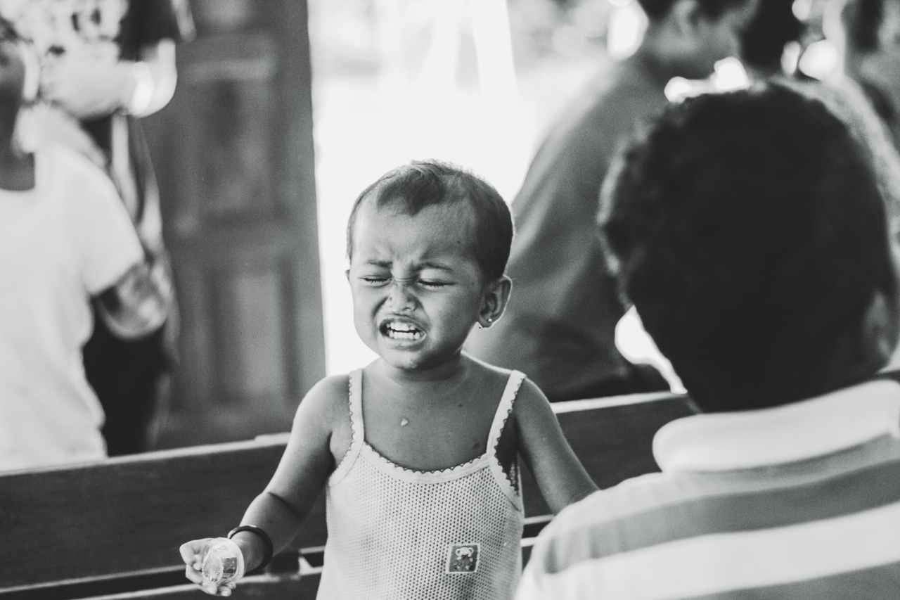 grayscale photography of child in spaghetti strap top