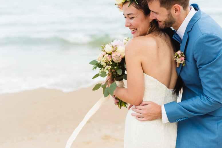 man hugging woman near seashore